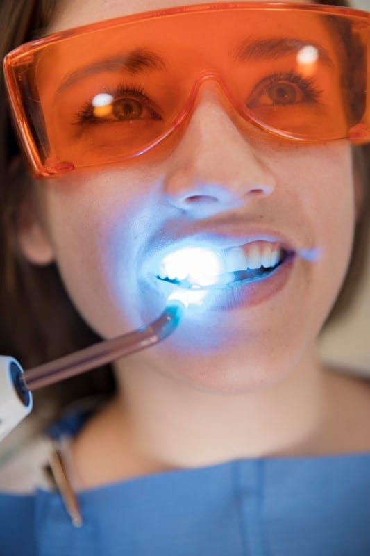 patient with glasses and dental laser