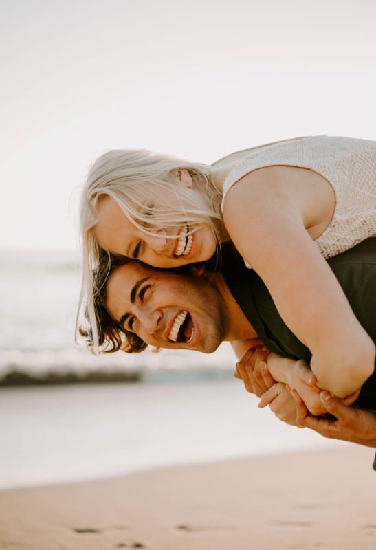 happy couple with a smiling face on the beach