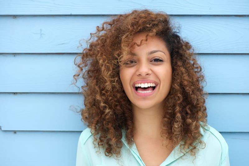 smiling girl with curls